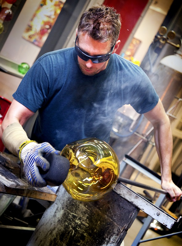 Brad in the hot bshop working on glass sculpture
