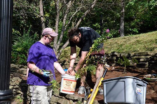 Students Austin Aiken (left) and Jake Passmore prepare to place some plants in the shade garden.
