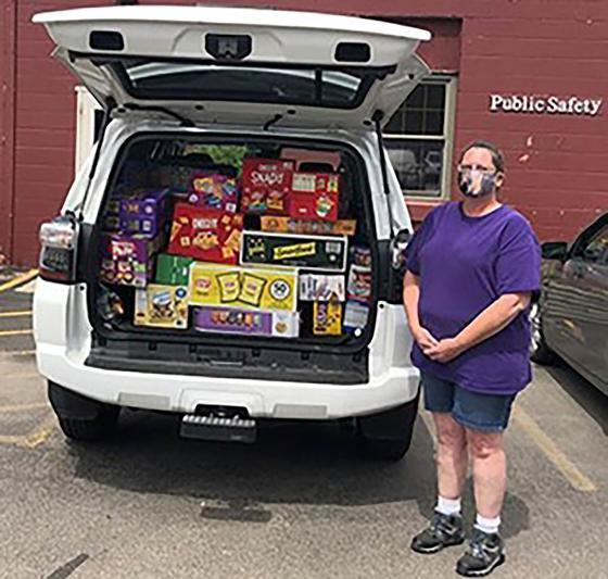Kelly Stephen of Hornell delivering snacks to students