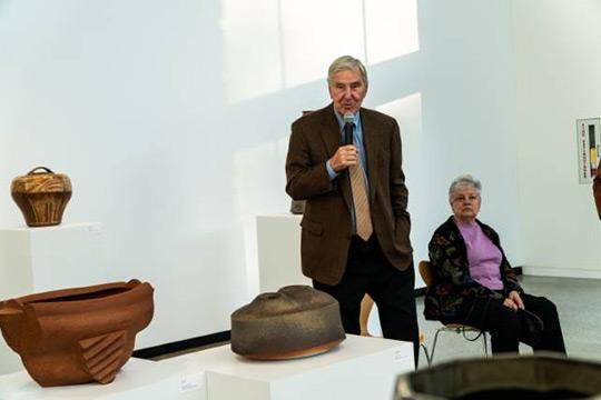 Marlin Miller talks at the opening reception for Materiality as his wife, Ginger, looks on.