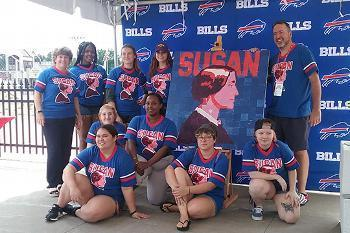 Members of Art Force 5 with the Susan B. Anthony mosaic created at Buffalo Bills Training Camp.