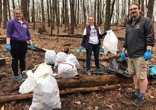 Students (from left) Natalie Poklop, Ashlee Wilmier and Seth Steele helped clean up Pine Hill Trails
