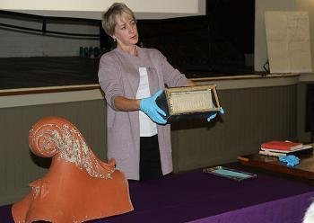 Laurie Lounsberry Meehan, Alfred University archivist, holds the open time capsule