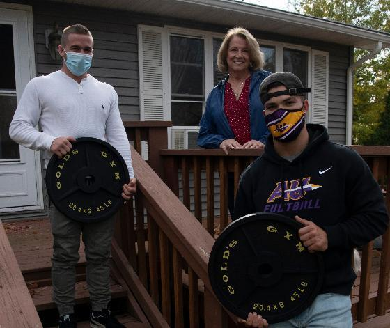 Spencer Chaput (left) and Zach Leinenbach (right) with some of the weights Sheila Foreman gave them.