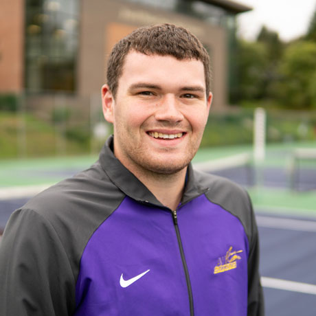 Jordan Crouch smiling at tennis courts