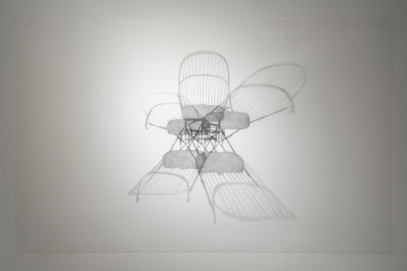 Graphite drawing of a chair with five radiating shadows