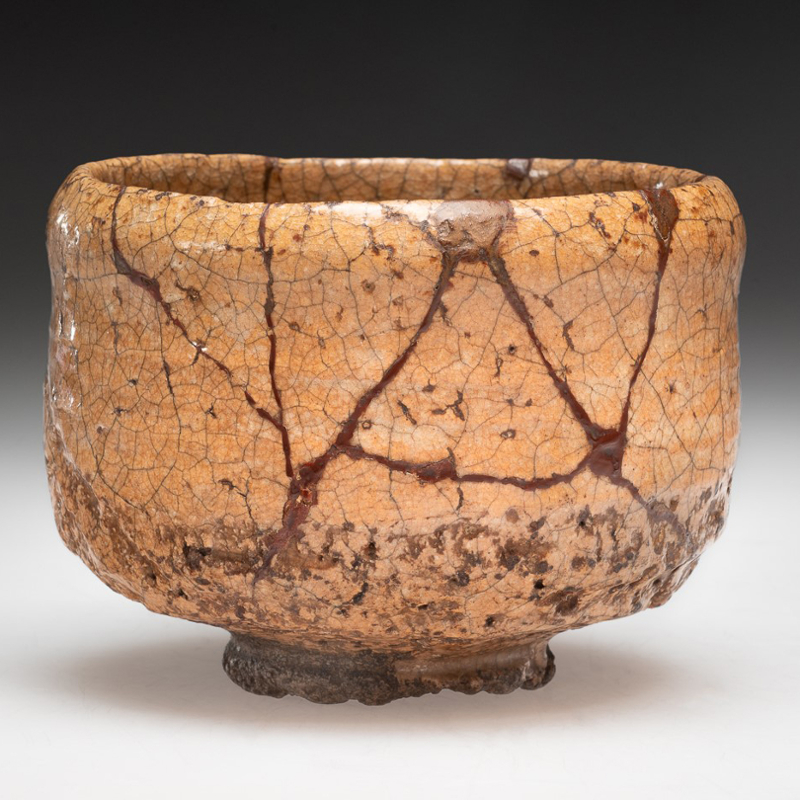 Mended Hagi ware teabowl, stoneware with amber glaze and lacquer repairs
