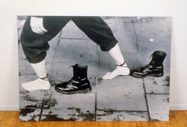 black and white photo bare feet next to shoes